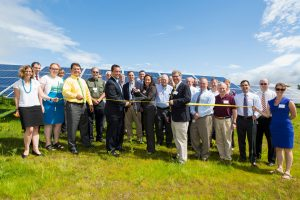GAAMHA, Inc. CEO Tracy Hutchinson, Gardner Mayor Mark Hawke and others cutting the ribbon.